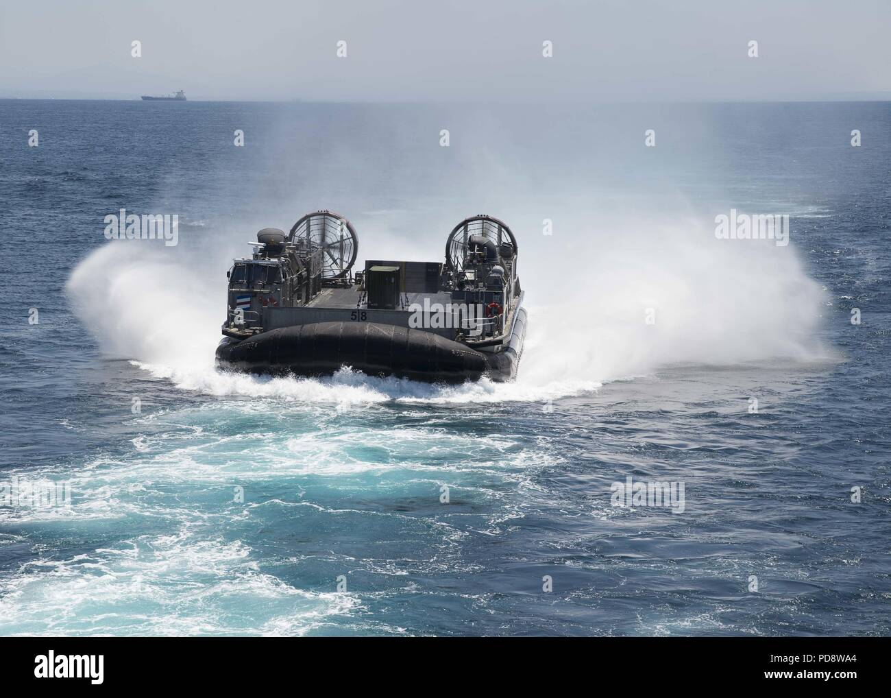 180703-N-XK809-118 PACIFIC OCEAN, (July 3, 2018) Landing craft air cushion (LCAC) 58, assigned to Assault Craft Unit (ACU) 5, approaches the well deck of the amphibious assault ship USS Bonhomme Richard (LHD 6), July 3, 2018. Bonhomme Richard is currently underway in the U.S. 3rd Fleet area of operations. (U.S. Navy photo by Mass Communication Specialist 3rd Class William Sykes). () - Stock Image