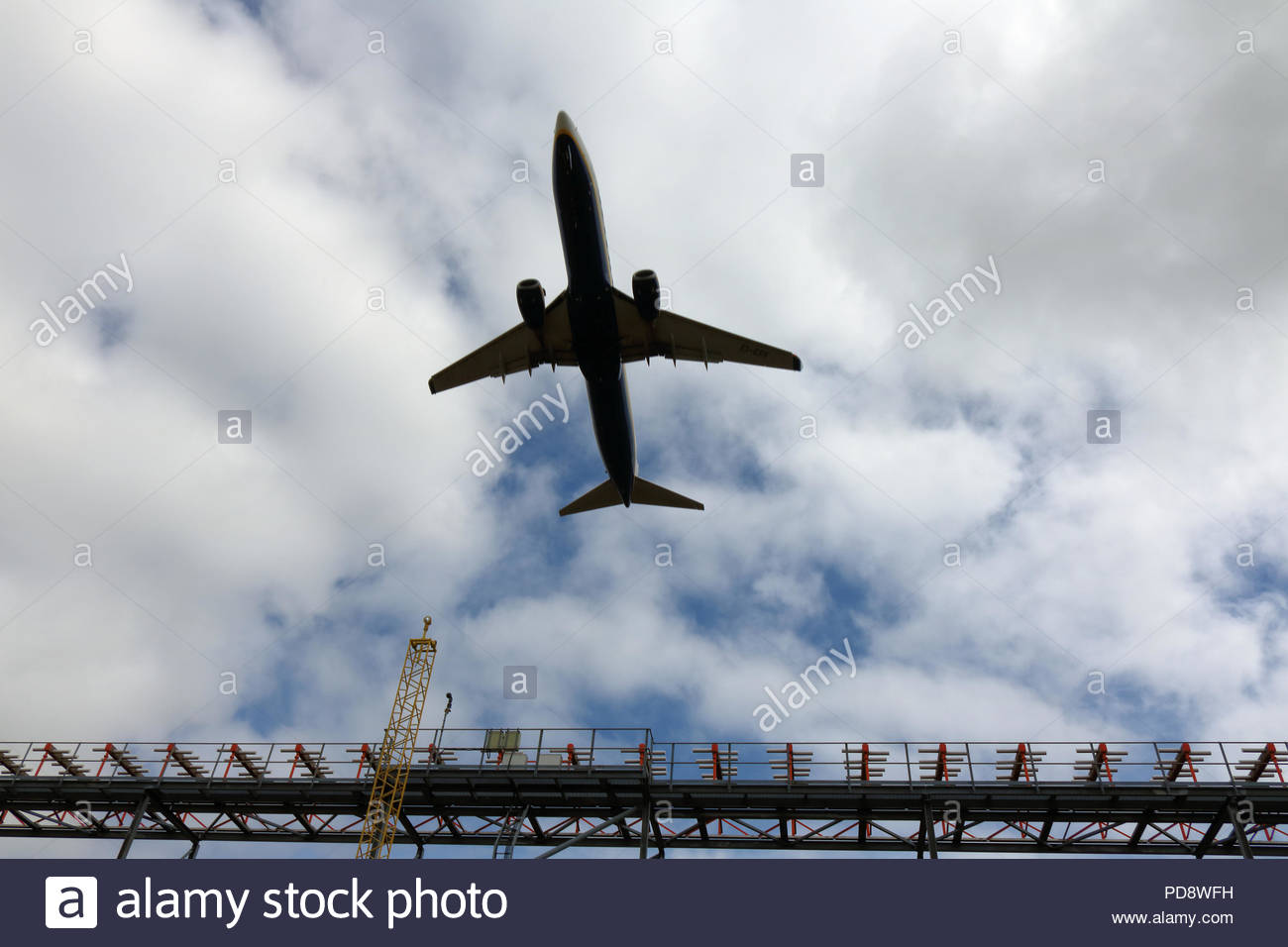 Aircraft departing Bristol airport overflying ILS equipment at the end of Runway 27, Bristol, UK - Stock Image