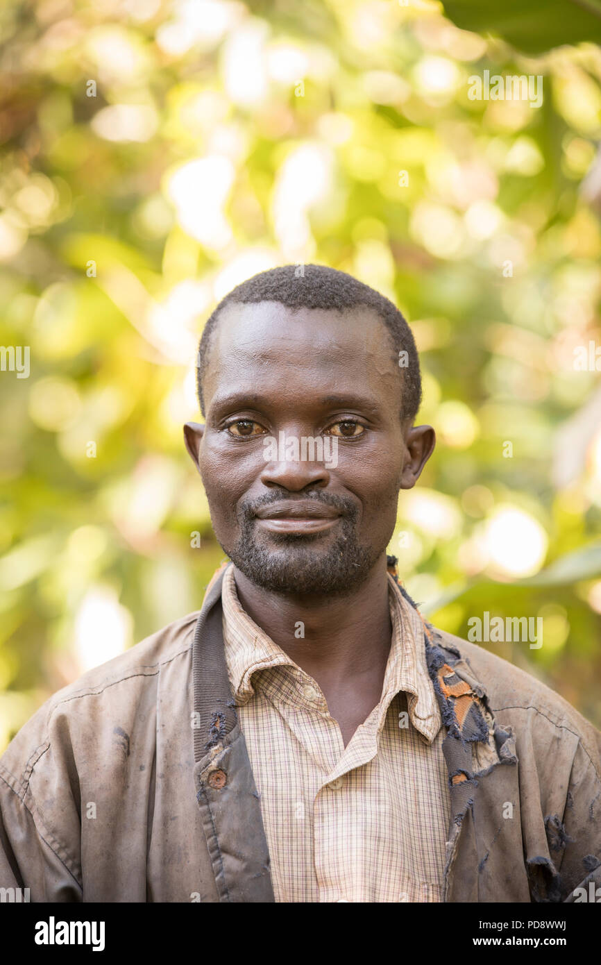 Portrait of a male cocoa farmer in Mukono District, Uganda. - Stock Image