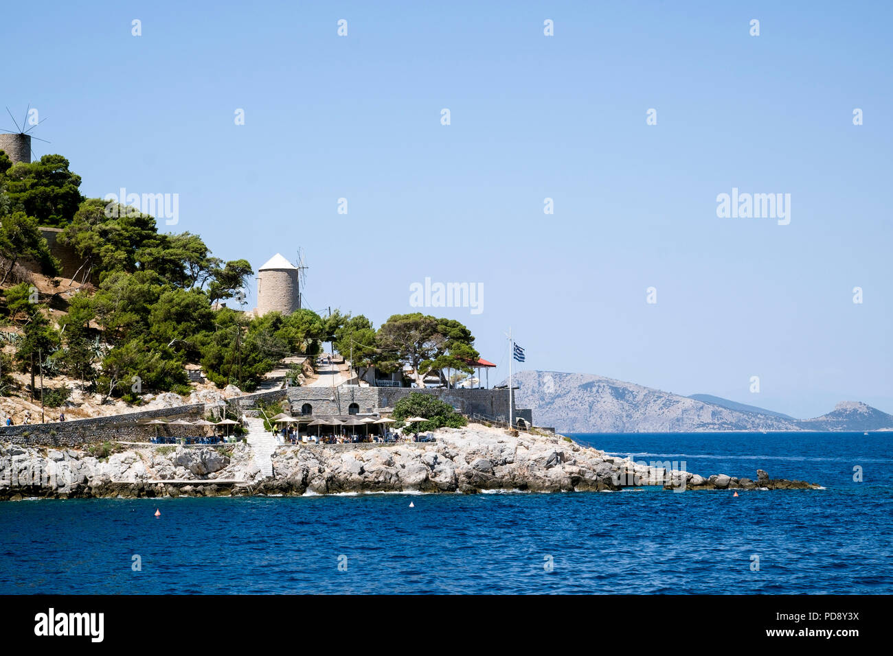 A rocky promontory next to the footpath from Hydra Port to Kamini bay.  Close to the main town, and below the traditional windmill, on Hydra island. - Stock Image