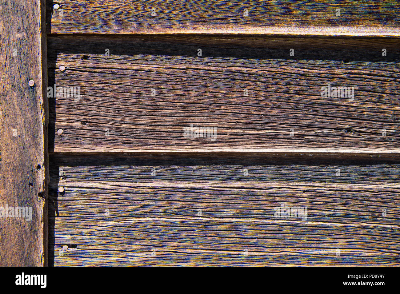 Weathered wood plank siding rustic background texture with natural brown color tones Stock Photo