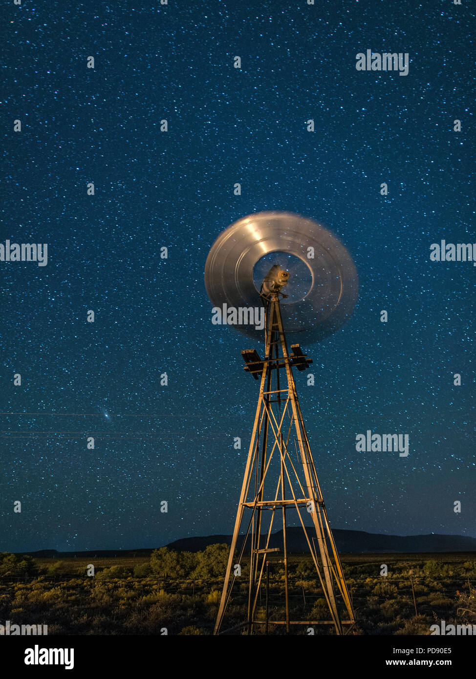 Windmill and stars in the Karoo region of South Africa. - Stock Image