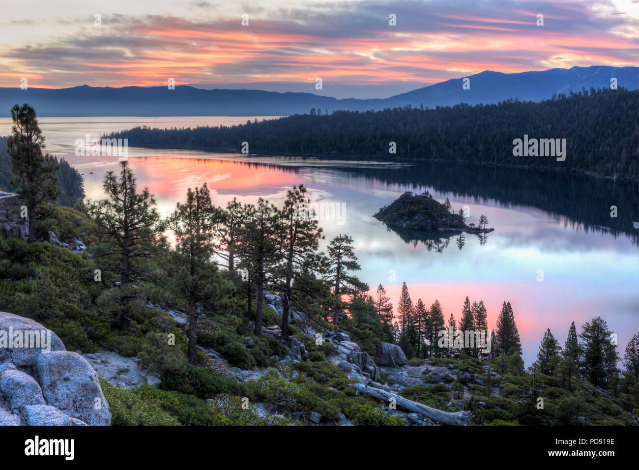 Colorful sunrise over Emerald Bay and Eagle Point off Lake Tahoe in California. Stock Photo