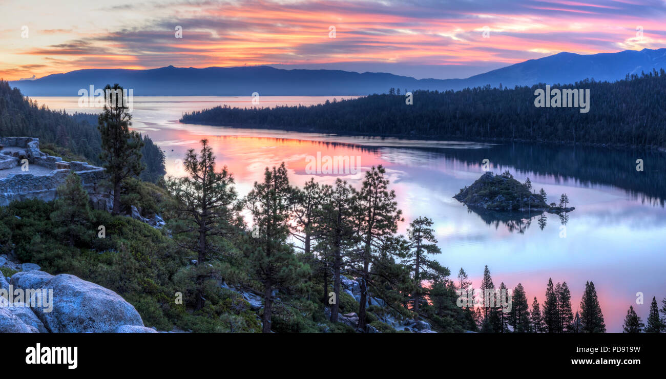 Panoramic view of a colorful sunrise over Emerald Bay and Eagle Point off Lake Tahoe in California. Stock Photo
