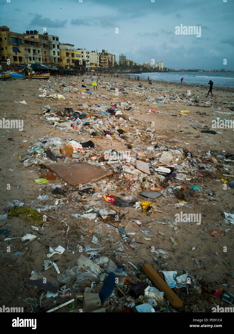 Plastic garbage pollution covers sand at Versova beach, Mumbai, India - Stock Image