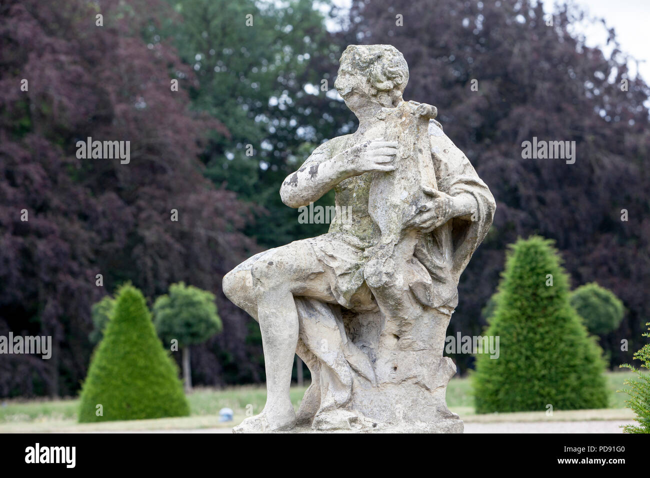 A baroque lyre-player, sculpture at Nordkirchen Moated Palace, Germany - Stock Image