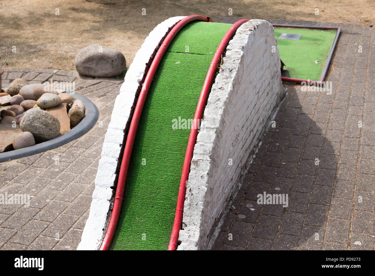Mini golf green obstacle hole - Stock Image