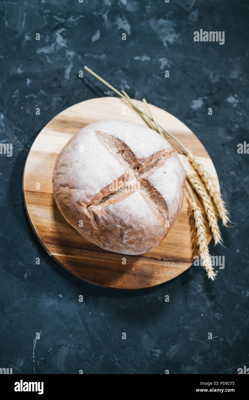 Loaf of fresh round bread - Stock Image