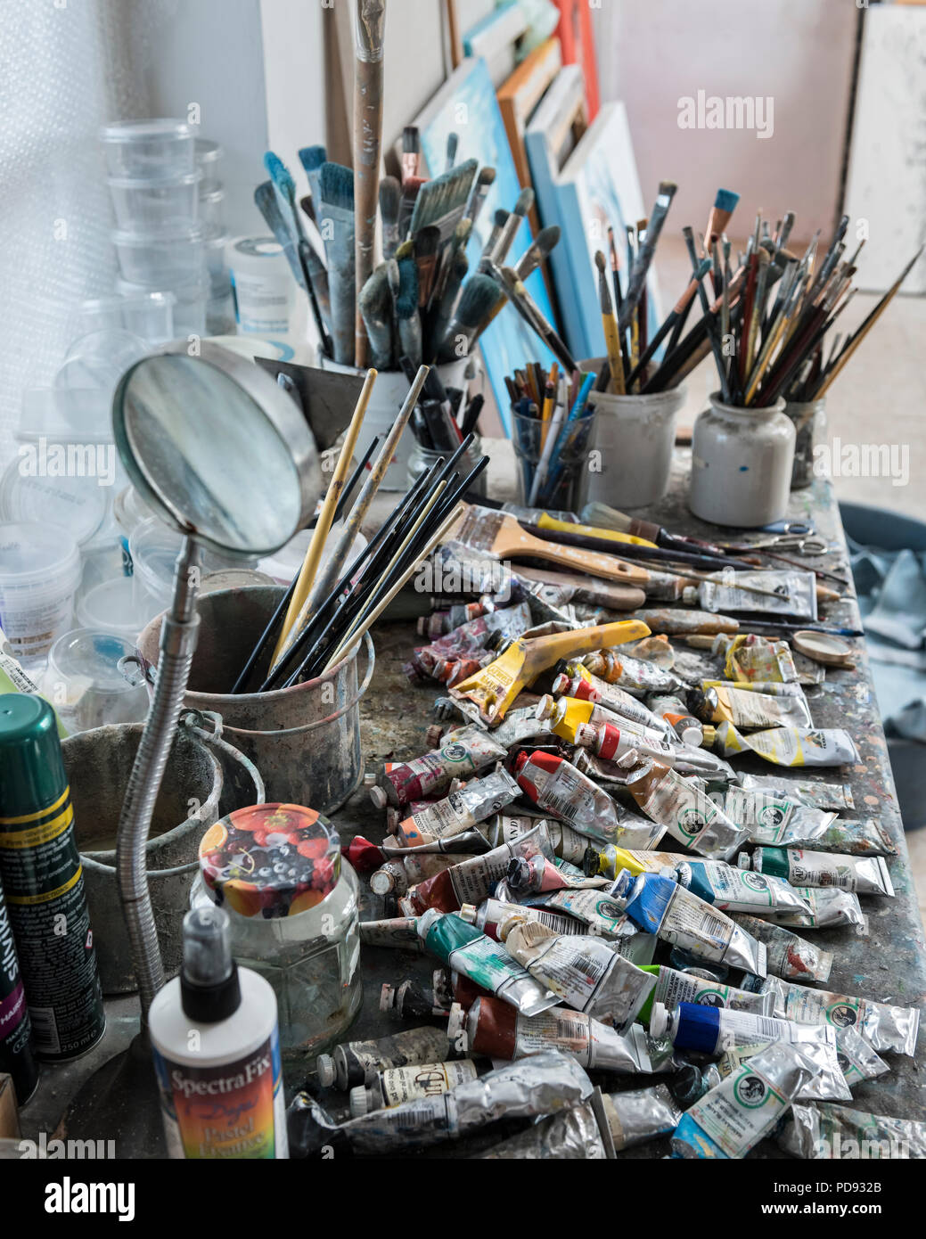 Paint brushes and oil paints in an artist's studio - Stock Image