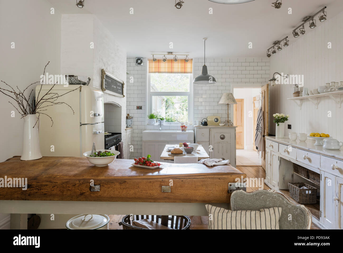 Rustic style kitchen with a contemporary industrial edge rustic style kitchen with a contemporary industrial edge freestanding units range cooker and metal pendant lights aloadofball Image collections