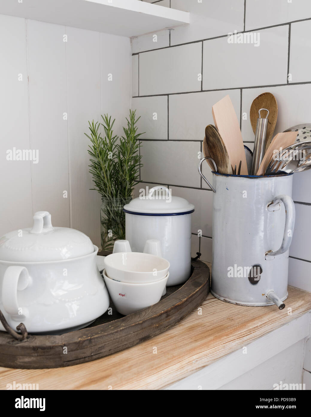Detail of enamelware and cooking utensils - Stock Image
