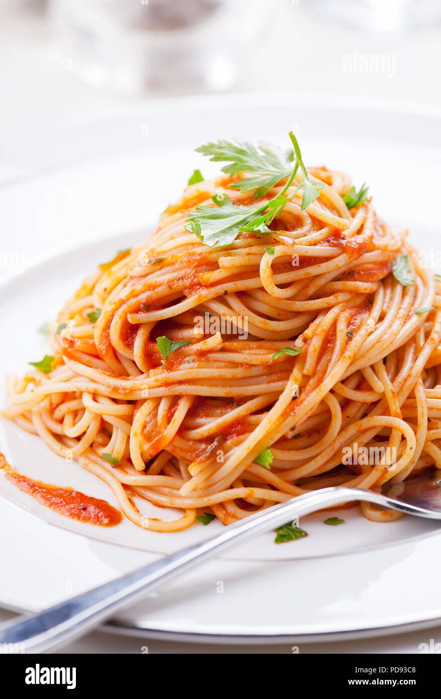Plate of pasta with homemade tomato sauce and parsley - Stock Image