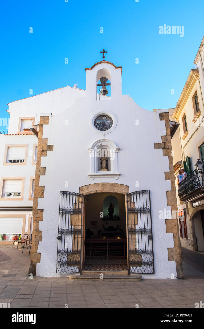 chapel of mare de deu del socors in the town of tossa de mar on the costa brava, spain. - Stock Image