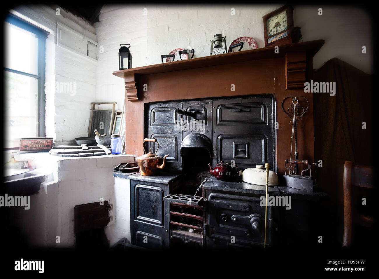 Atmospheric interior shot of the kitchen range in a house dating around 1915, situated in the grounds of the Black Country Living Museum, Dudley, UK. - Stock Image