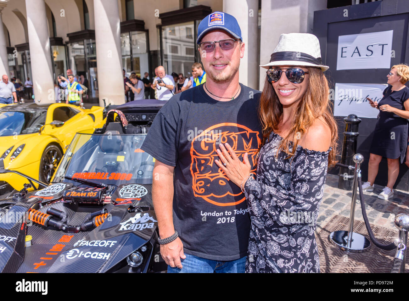 Melissa Owings and Travis Rasmussen, entrants in the Gumball 3000 rally with their KTM X-Bow GT, only a few days before they plan to wed. - Stock Image