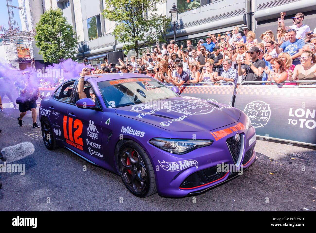 Covent Garden, London, UK.  05/08/2018.  Purple Alfa Romeo Guila leaves at the start of the 2018 Gumballl 3000 rally. - Stock Image