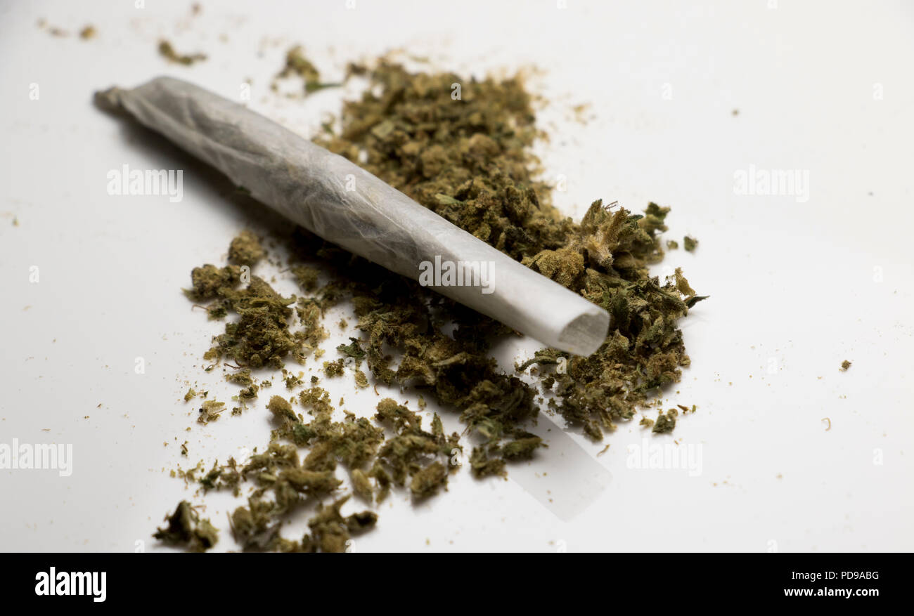 One Marijuana Cigarette on a table. Rolled joint of Mary Jane. - Stock Image