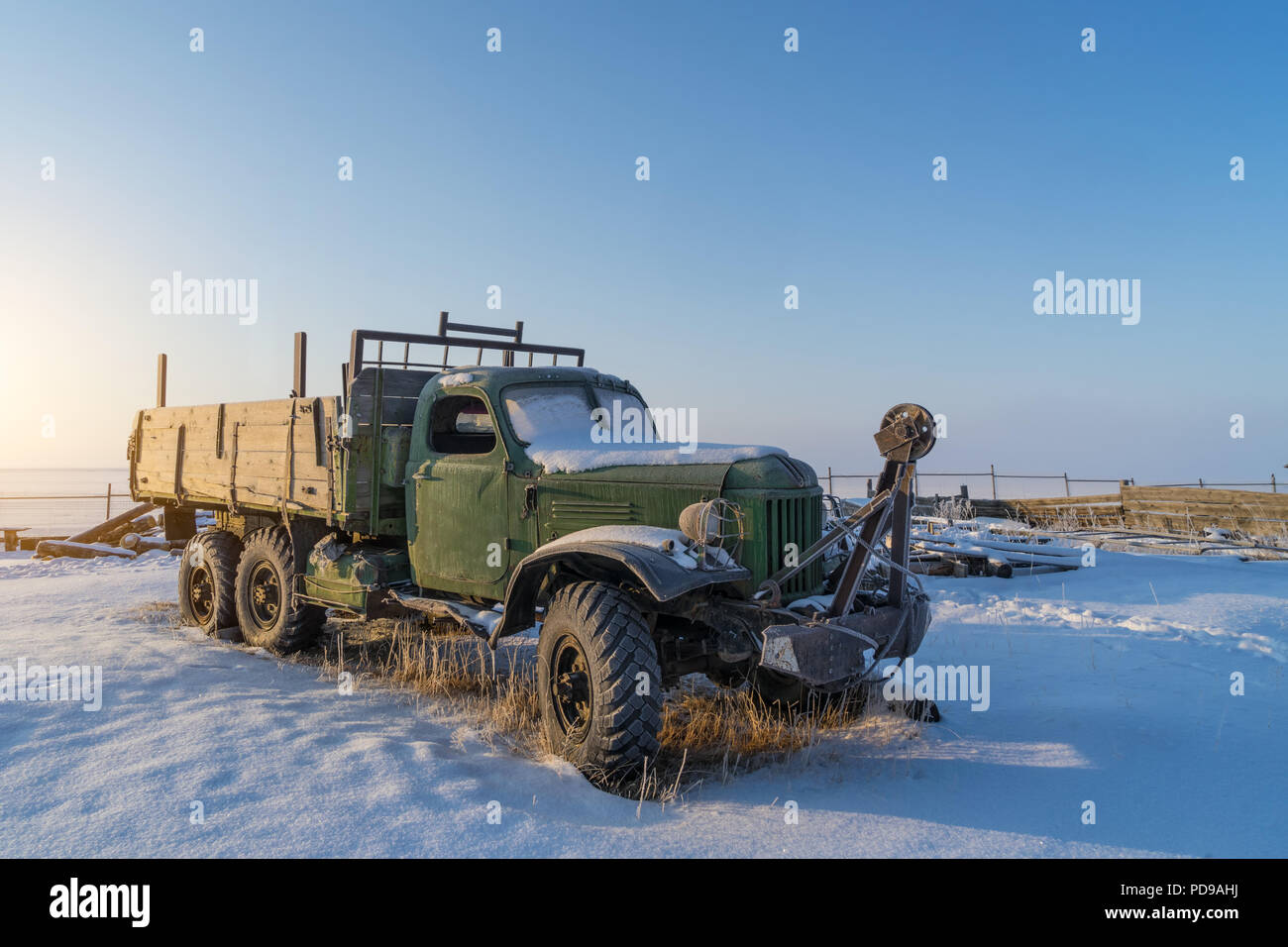 Old Russian truck covered by snow in the winter  Baikal lakeI