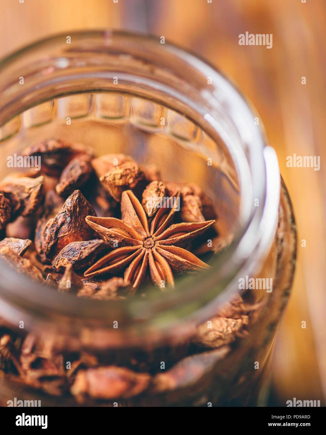 Jar of Star Aniseeds. View through the Bottleneck. Vertical Orientation. - Stock Image