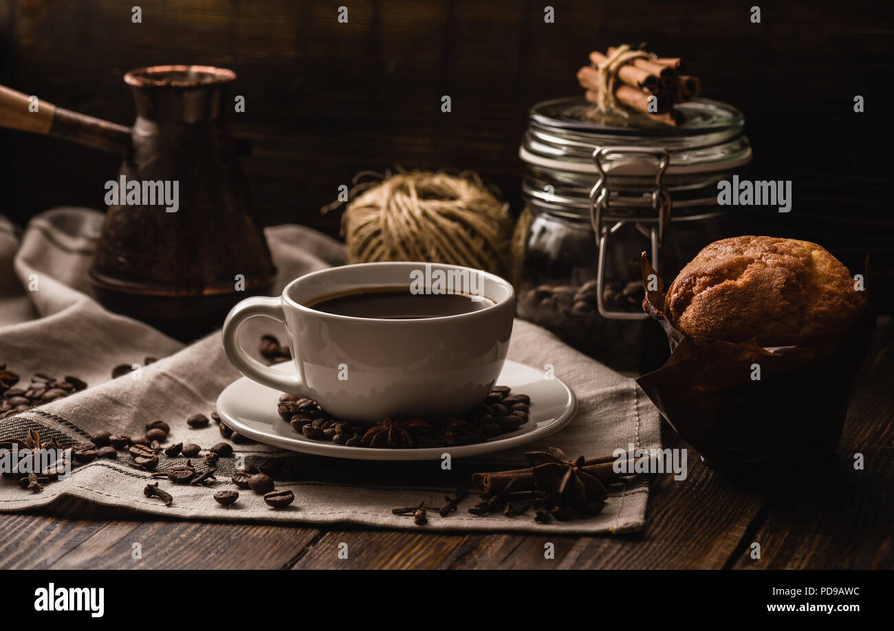 Cup of Coffee with Muffin, Different Spices and Some Kitchen Equipment - Stock Image