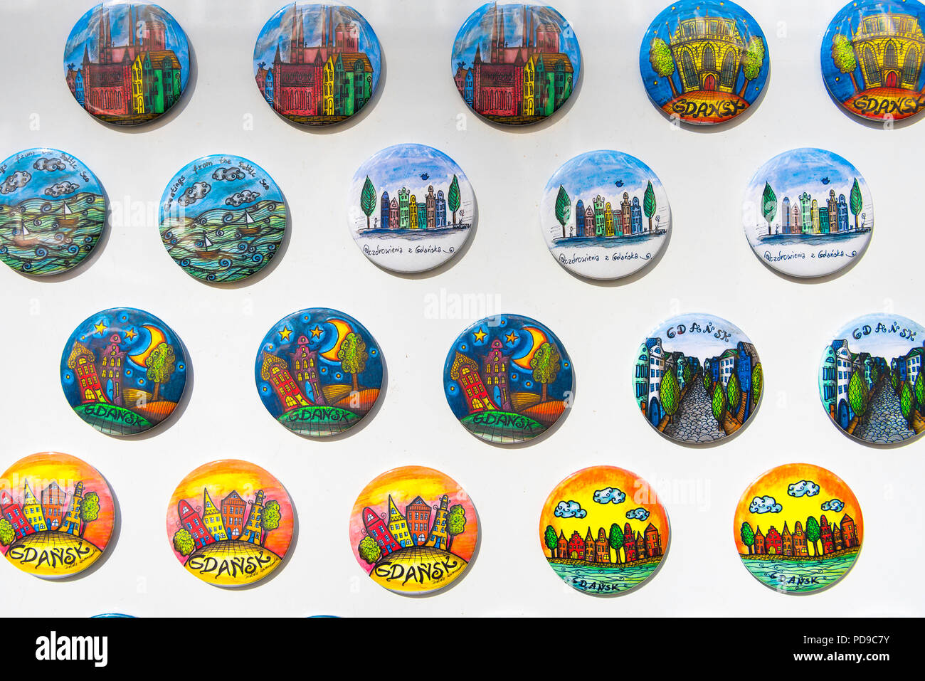 Gdansk souvenir, a display of colorful souvenir badges illustrating