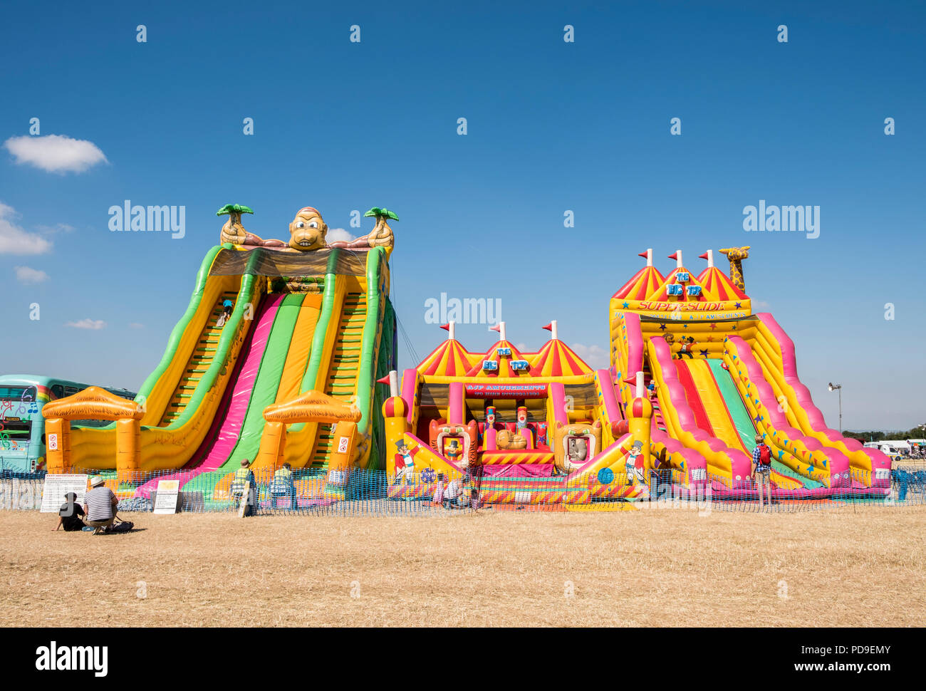 Giant Inflatable slides at a country fair. - Stock Image