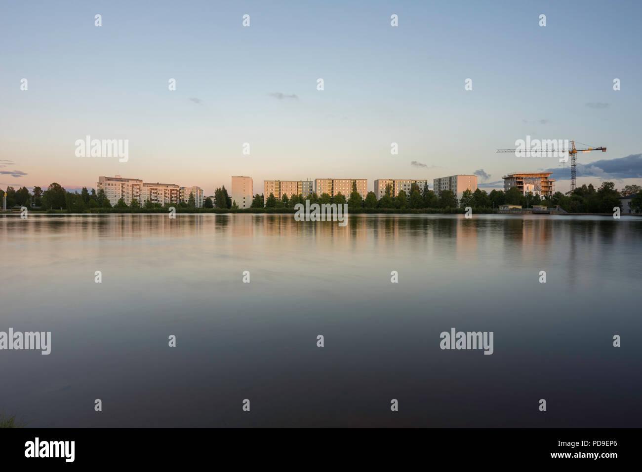 Residential buildings seen from across river Oulujoki in Oulu, Finland - Stock Image
