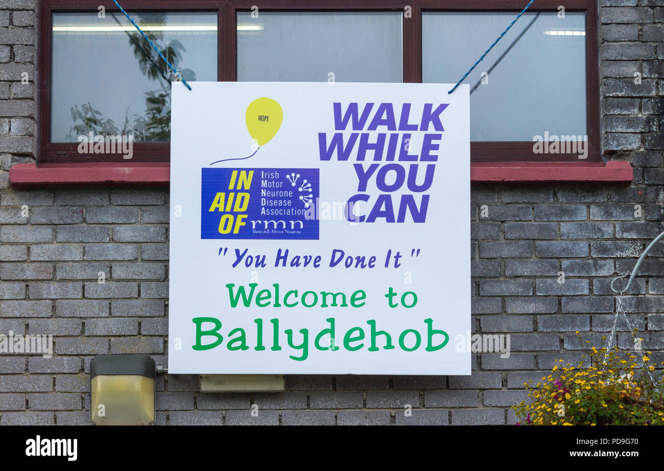 walk while you can banner for IMNDA Irish Motor Neuron Disease Association hanging from a building window. - Stock Image