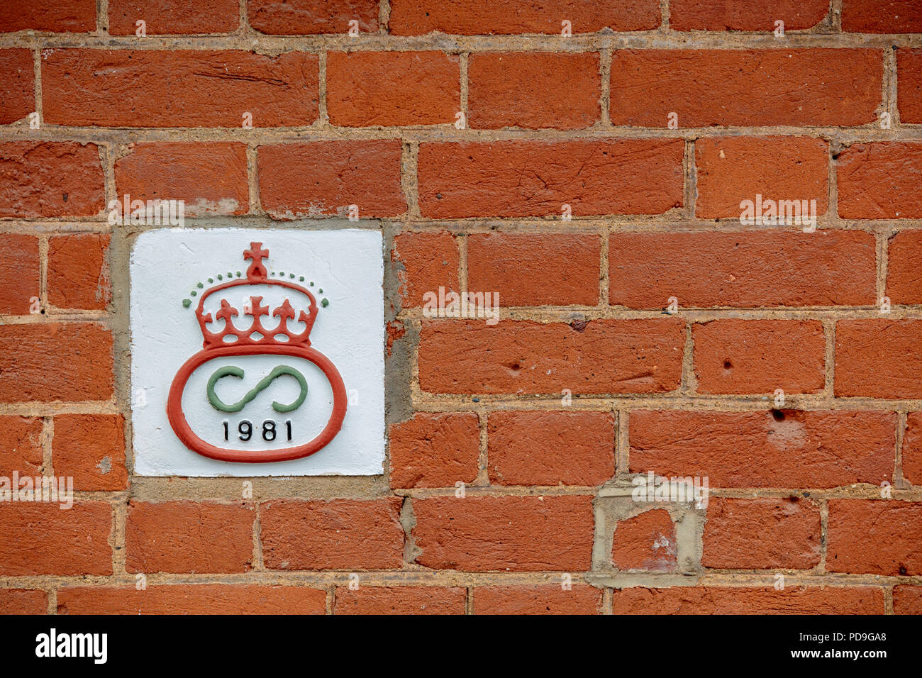 Wall of house with red brick wall and year of building sign, Hampstead, London. - Stock Image