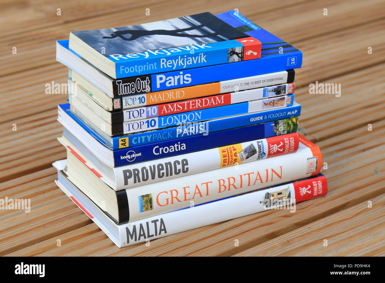 Stack of European travel guide books - Stock Image