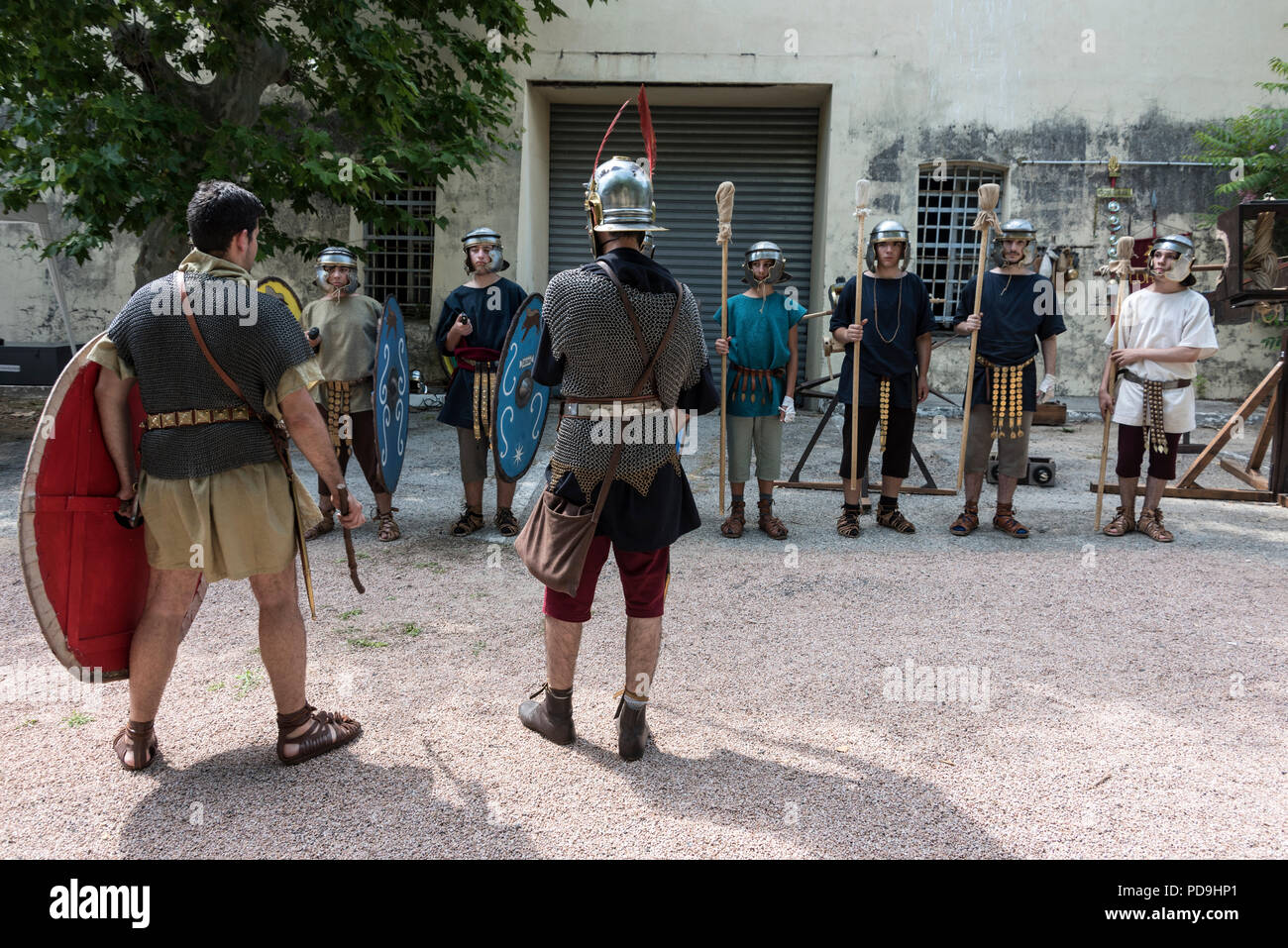 A group of Roman soldiers taking part in a battle re-enactment during a history event weekend held within the walls of Ajaccio citadel in Ajaccio on C - Stock Image