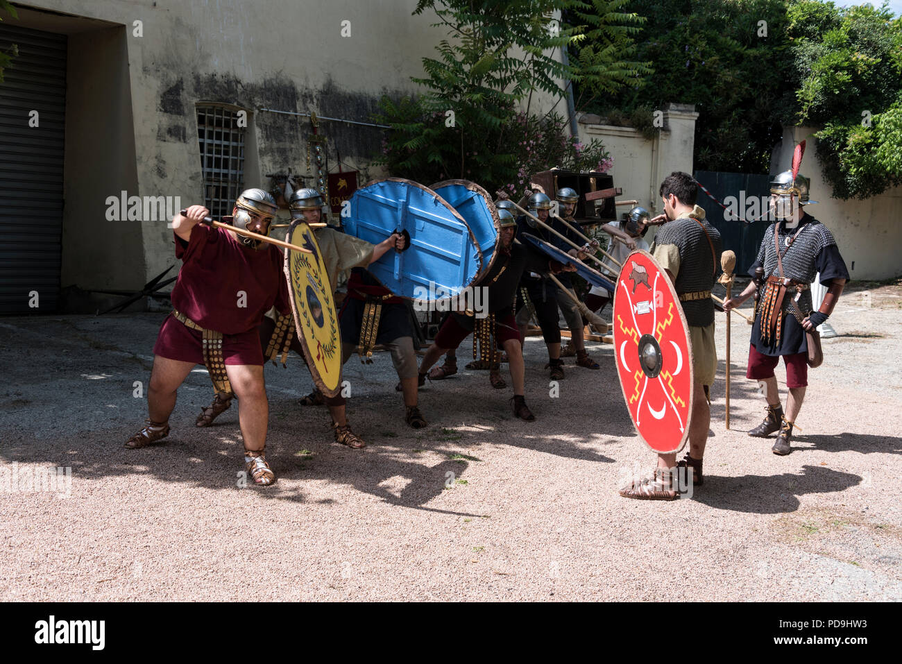 A  group of Roman soldiers demonstrating their battle training during a history event weekend held within the walls of Ajaccio citadel in Ajaccio on C - Stock Image