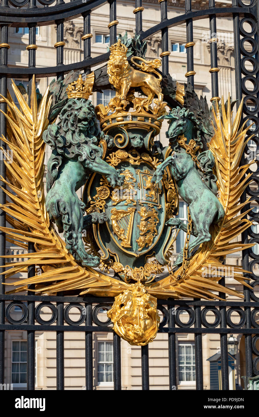 London England August 05, 2018 Royal crest on the gate of Buckingham Palace, the London residence of Her Majesty Queen Elizabeth 2nd - Stock Image