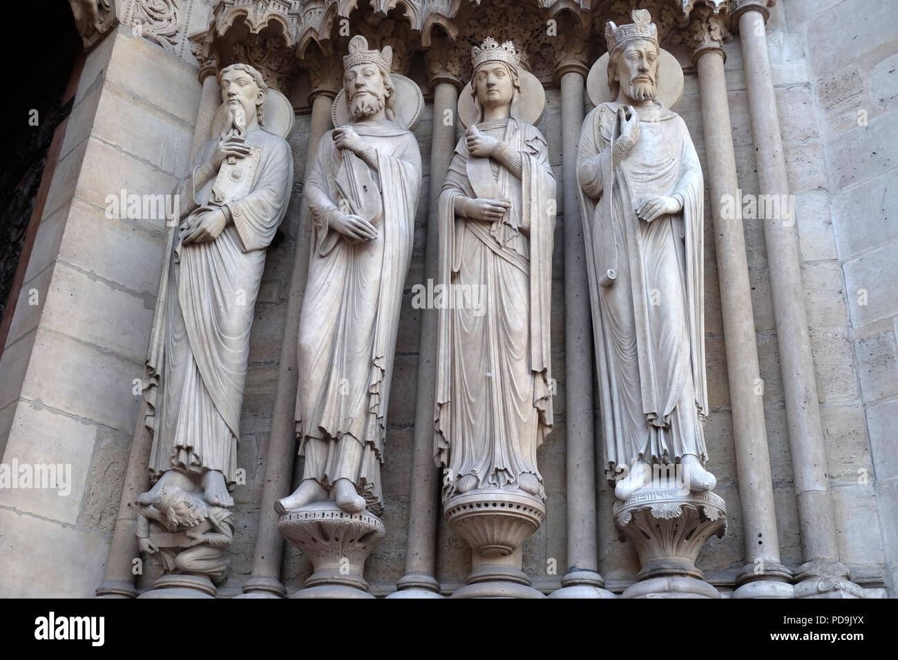 Saint Paul, King David, a queen, and another king, Portal of St. Anne, Notre Dame Cathedral, Paris, UNESCO World Heritage Site in Paris, France Stock Photo