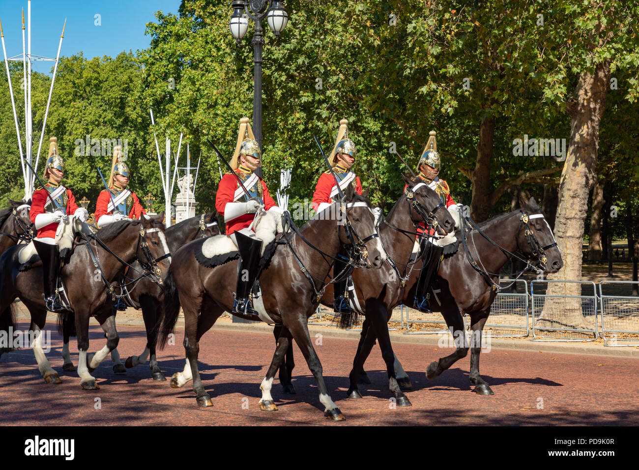 London England August 05, 2018 A detachment of soldiers of The Lifeguards regiment of the Household Cavalry rides along the Mall outside Buckingham Pa Stock Photo