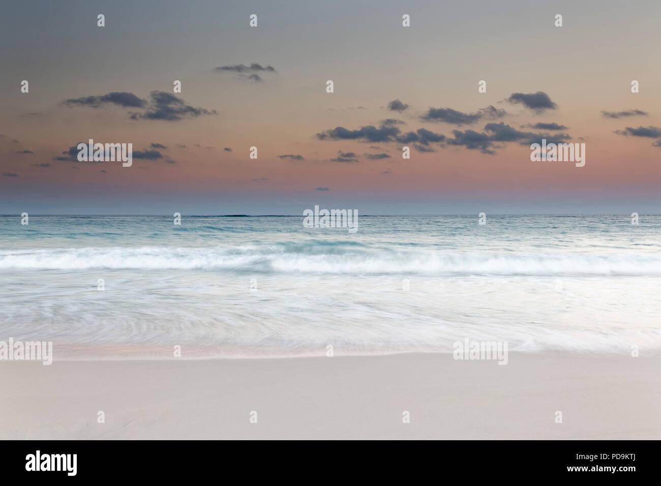 Surf during dusk over the sea, Playa Bavaro, Punta Cana, Dominican Republic - Stock Image