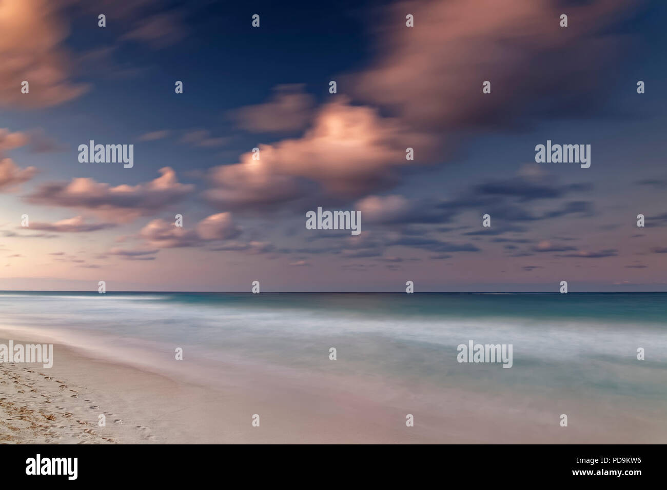 Afterglow with clouds by the sea, Playa Bavaro, Punta Cana, Dominican Republic - Stock Image