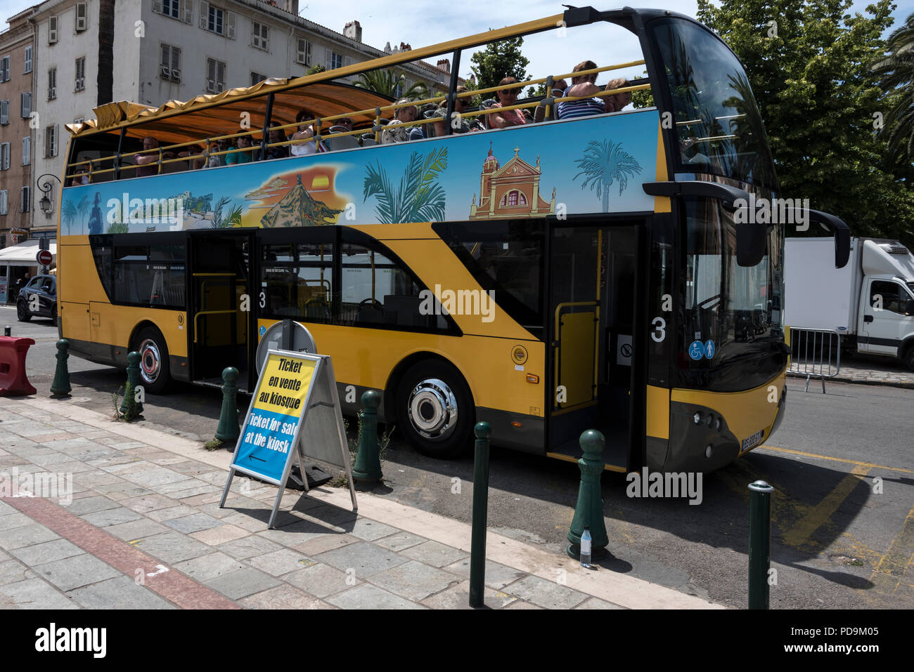 A tourist double-decker bus in a street in Ajaccio on