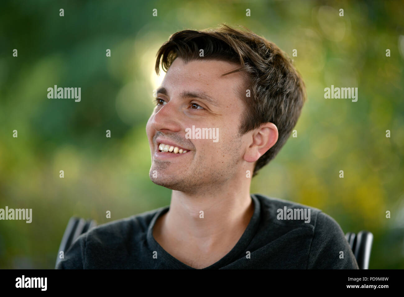 Young man, smiling, portrait, Germany - Stock Image
