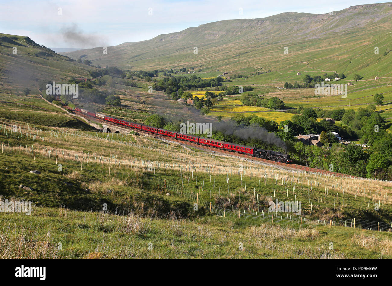45690 Leander heads past Aisgill viaduct on 5.6.18 with a returning Dalesman tour. - Stock Image