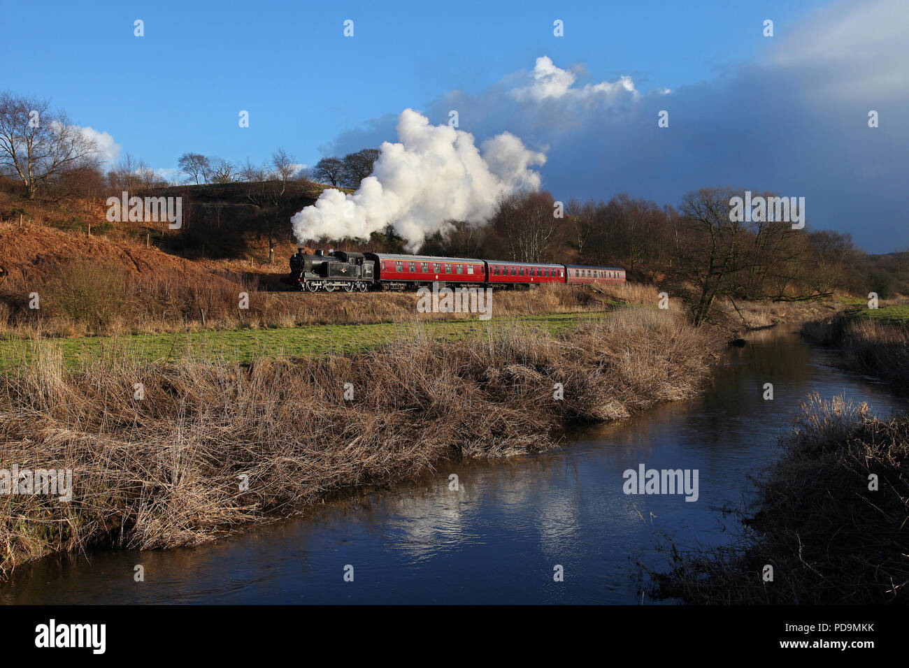 69621 approaches Cheddleton on the Churnet Valley Railway 21.2.15 - Stock Image