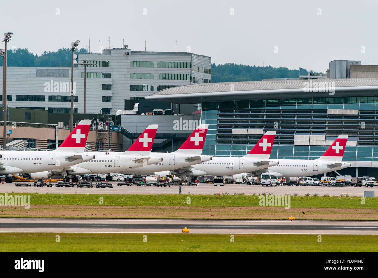 Tail fins of Swiss aircraft at Zurich Airport, Switzerland - Stock Image