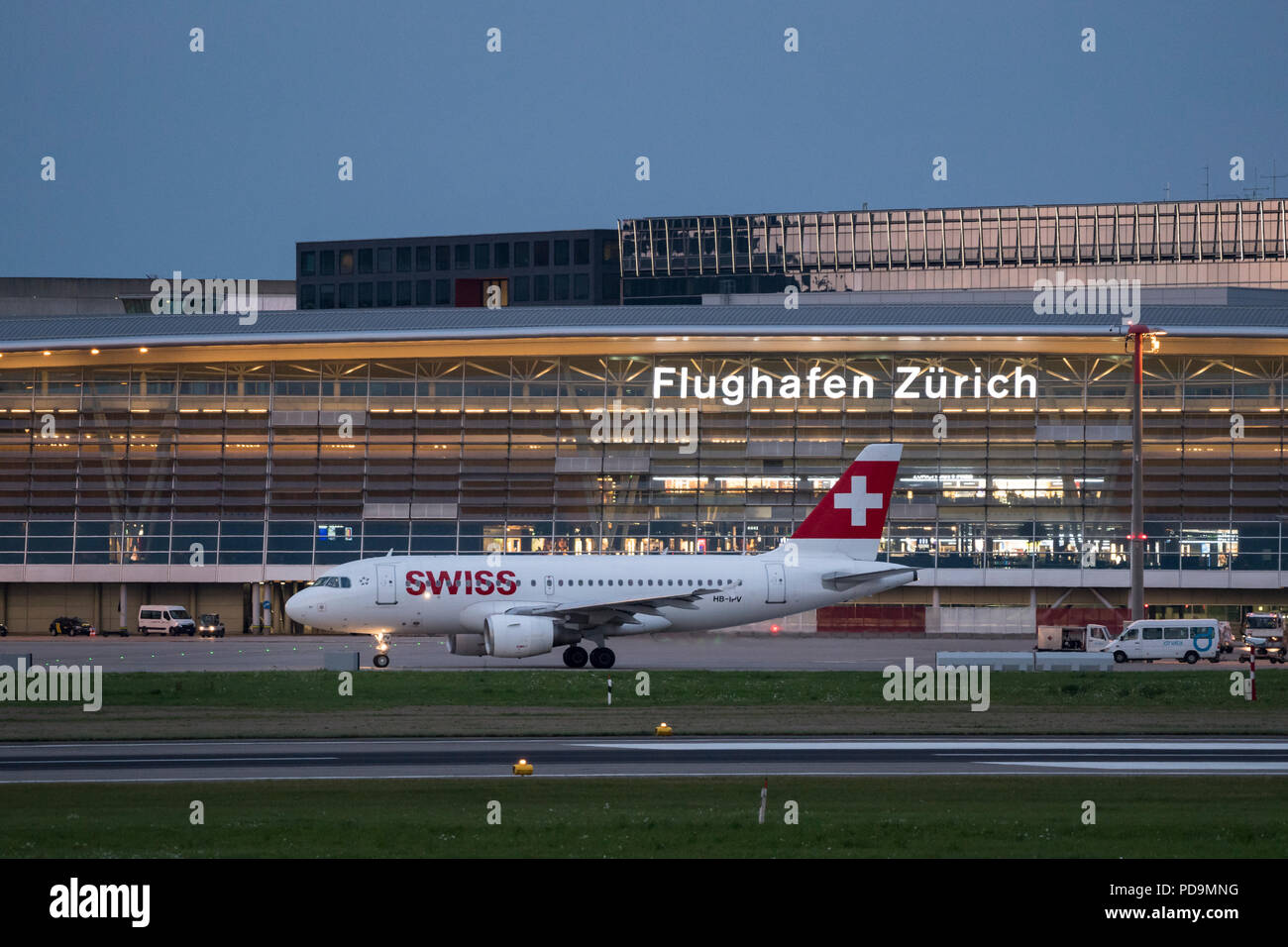 Airbus A319-112 of the Swiss airline at Zurich Airport, at dusk, Zurich, Switzerland - Stock Image