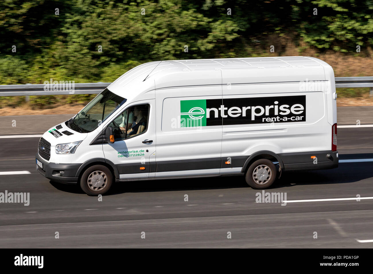 9916364870 Ford Transit of Enterprise on motorway. Enterprise Rent-A-Car is an American