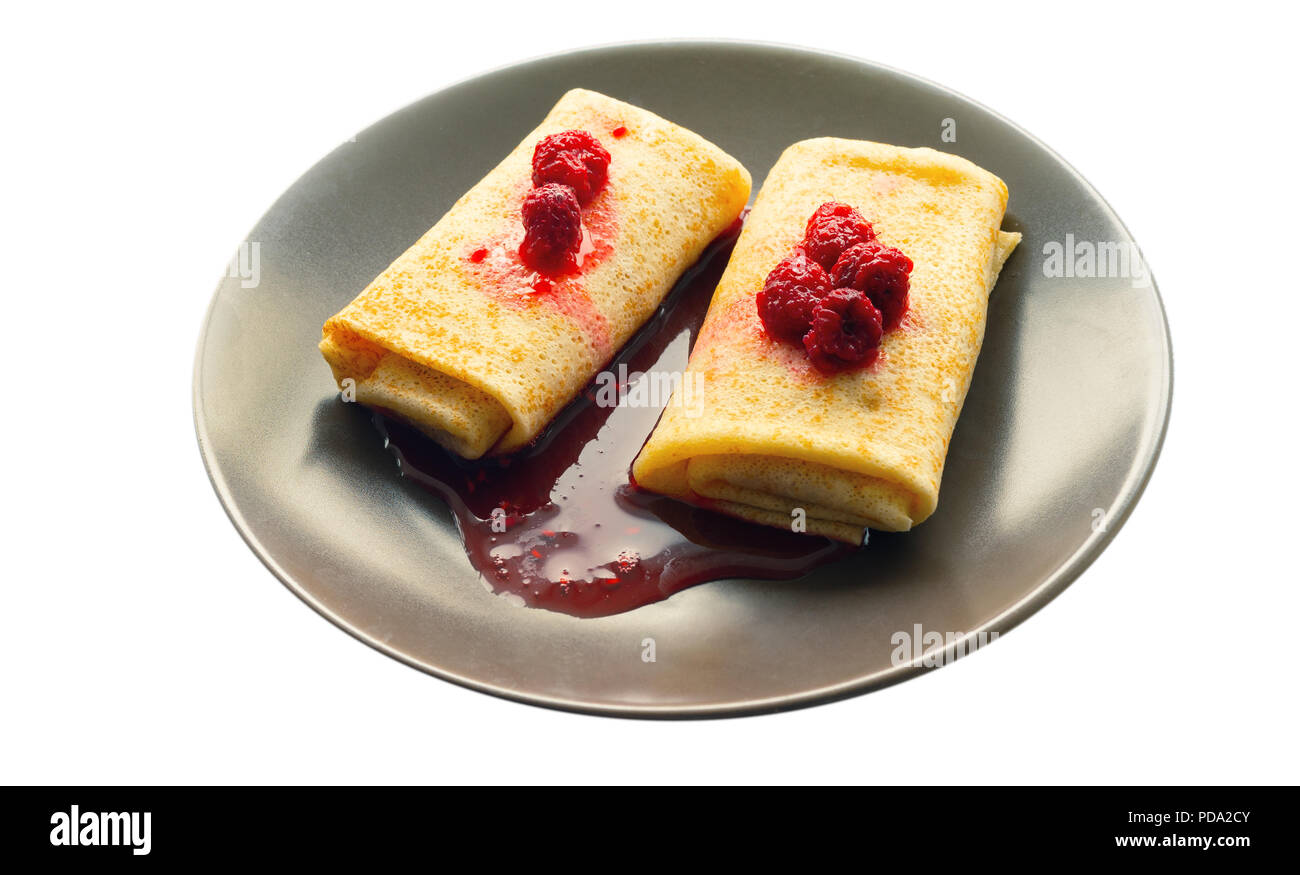 pancakes with its jam topping - Stock Image