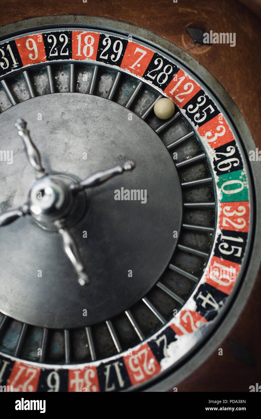 Close up of a roulette wheel with the ball on red 12 - Stock Image