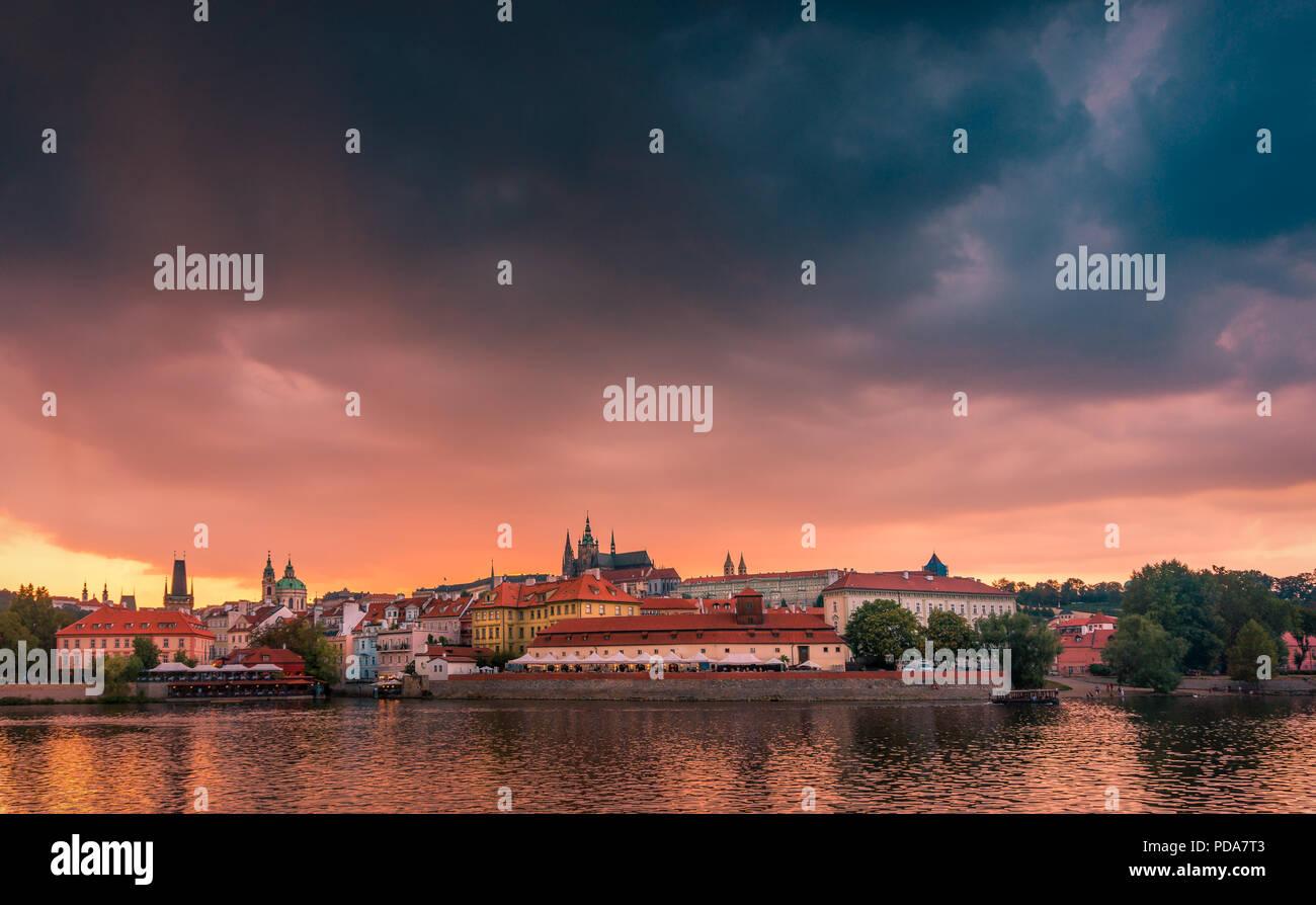Stunning cityscape of Prague on a sunset in Czech Republic. Vltava river, Prazsky hrad (Prague castle). Stock Photo