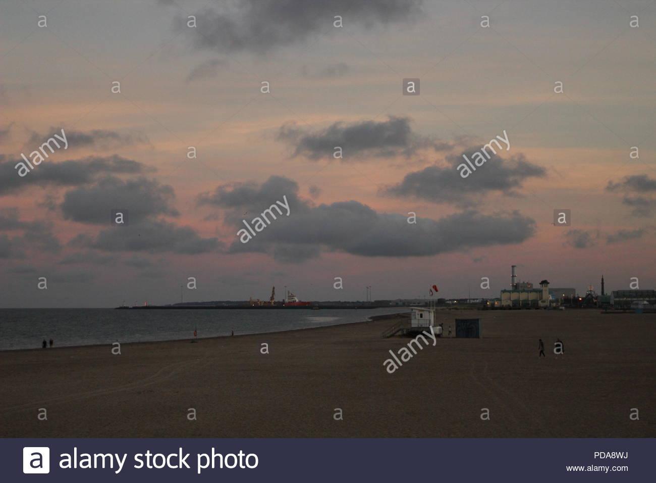 Beach scene at Sunset, Great Yarmouth beach Norfolk, UK - Stock Image