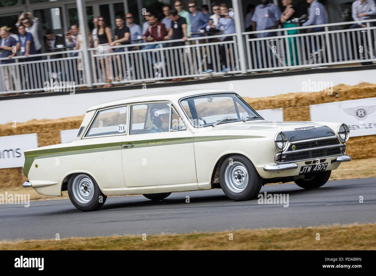 1965 Ford-Lotus Consul Cortina Mk1 BSCC car with driver Stuart Clark at the 2018 Goodwood Festival of Speed, Sussex, UK. Stock Photo