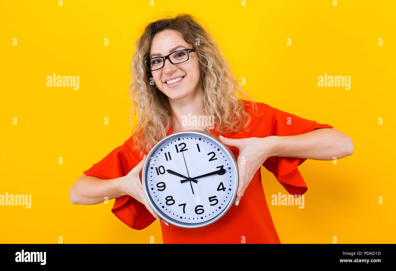 Woman in dress with clocks - Stock Image